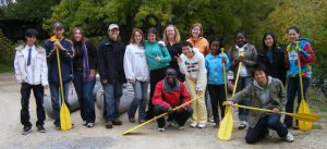 group of students with canoe paddles
