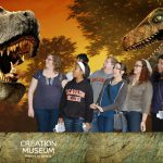 group of students pretending to be scared of dinosaurs