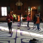 students walking a room size labyrinth