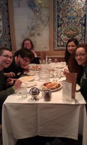 students eating a fancy dinner