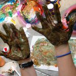 hands covered in finger paints